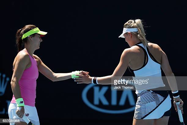 Sorana Cirstea of Romania and Carina Witthoeft of Germany compete against Timea Babos of Hungary and Anastasia Pavlyuchenkova of Russia in their...