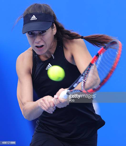 Sorana Cirstea of Romania competes with Ajla Tomljanovic of Croatia during 2014 China Open Qulifying at National Tennis Centre on September 26 2014...