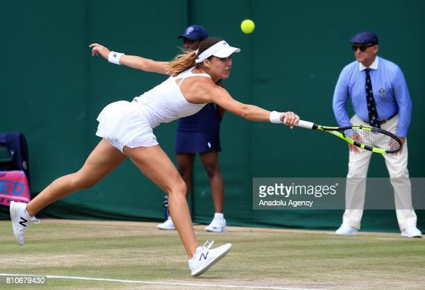 Sorana Cirstea of Romania in action against Garbine Muguruza of Spain on day six of the 2017 Wimbledon Championships at the All England Lawn and...