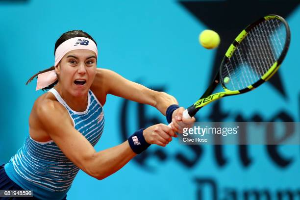 Sorana Cirstea of Romania in action against Kristina Mladenovic of France on day six of the Mutua Madrid Open tennis at La Caja Magica on May 11 2017...