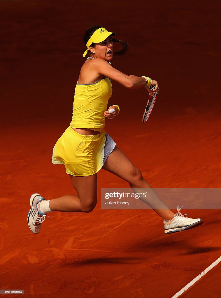 <a gi-track='captionPersonalityLinkClicked' href=/galleries/search?phrase=Sorana+Cirstea&family=editorial&specificpeople=4499606 ng-click='$event.stopPropagation()'>Sorana Cirstea</a> of Romania in action against Sara Errani of Italy during day three of the Mutua Madrid Open tennis tournament at the Caja Magica on May 6, 2013 in Madrid, Spain.