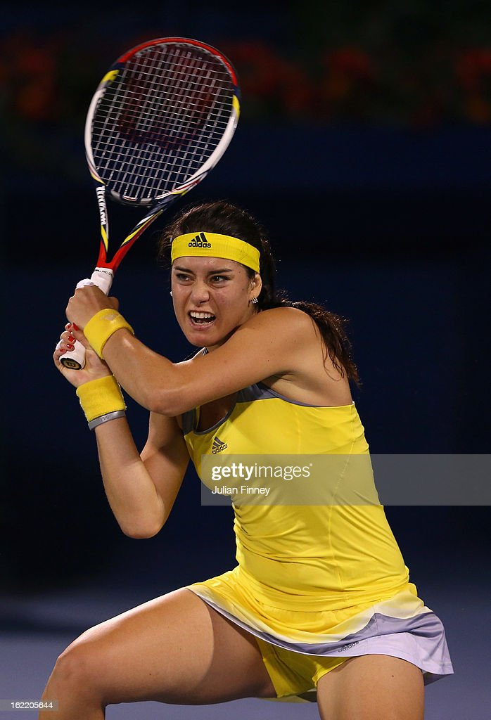 <a gi-track='captionPersonalityLinkClicked' href=/galleries/search?phrase=Sorana+Cirstea&family=editorial&specificpeople=4499606 ng-click='$event.stopPropagation()'>Sorana Cirstea</a> of Romania in action in her match against Sara Errani of Italy during day three of the WTA Dubai Duty Free Tennis Championship on February 20, 2013 in Dubai, United Arab Emirates.