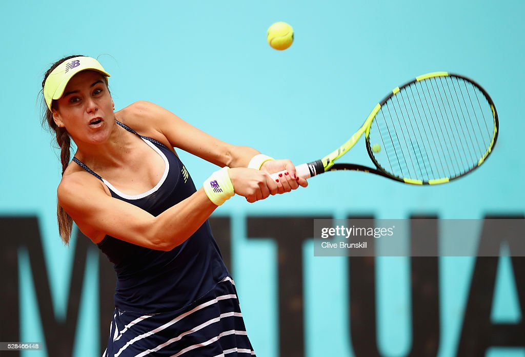 Sorana Cirstea of Romania plays a backhand against Dominika Cibulkova of Slovakia in their quarter final match match during day six of the Mutua Madrid Open tennis tournament at the Caja Magica on May 05, 2016 in Madrid,Spain