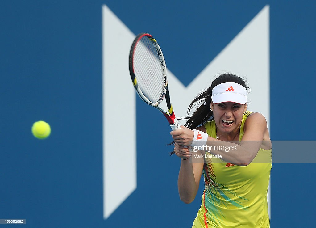 Sorana Cirstea of Romania plays a backhand in her first round match against Nina Bratchikova of Russia during day four of the Hobart International at Domain Tennis Centre on January 7, 2013 in Hobart, Australia.