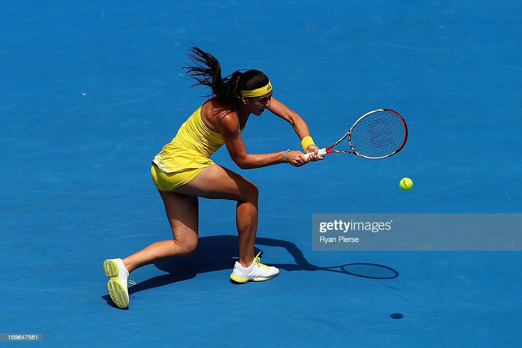 Sorana Cirstea of Romania plays a backhand in her third round match against Na Li of China during day five of the 2013 Australian Open at Melbourne Park on January 18, 2013 in Melbourne, Australia.