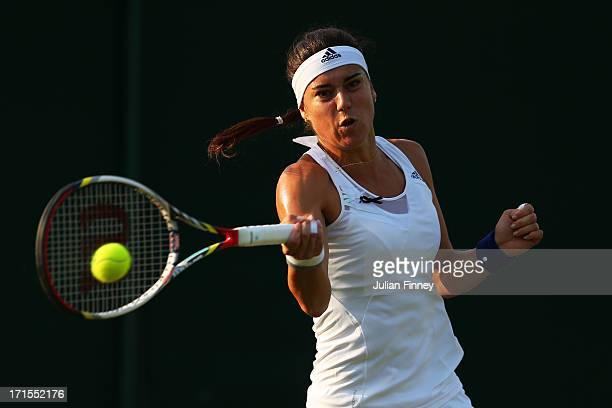 Sorana Cirstea of Romania plays a forehand during her Ladies' Singles second round match against Camila Giorgi of Italy on day three of the Wimbledon...