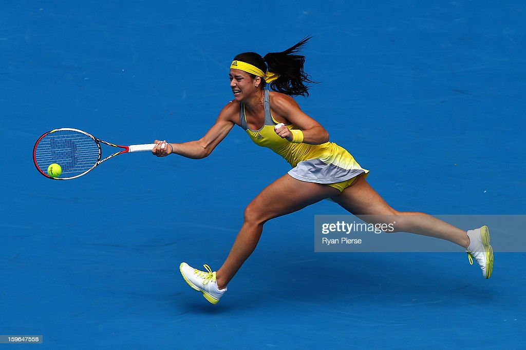 Sorana Cirstea of Romania plays a forehand in her third round match against Na Li of China during day five of the 2013 Australian Open at Melbourne Park on January 18, 2013 in Melbourne, Australia.