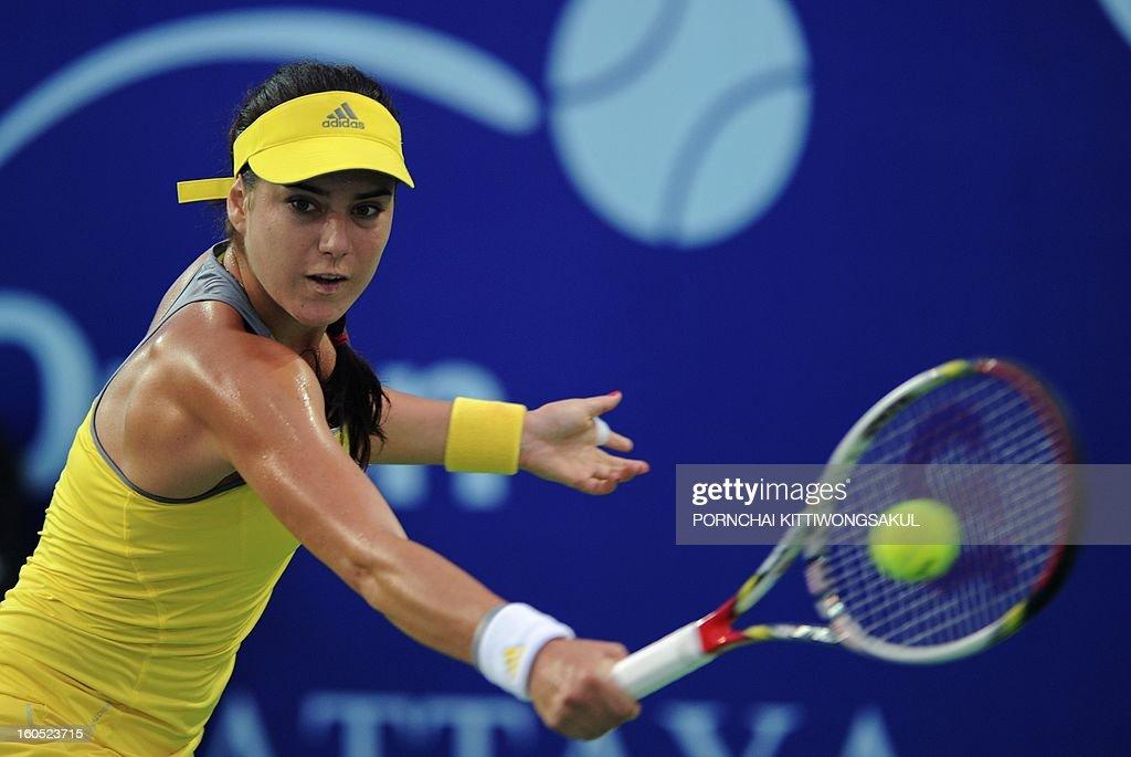 Sorana Cirstea of Romania plays a shot against Maria Kirilenko of Russia during the tennis women's singles semi-final round of the WTA Pattaya Open tennis tournament in Pattaya resort on February 2, 2013. AFP PHOTO/PORNCHAI KITTIWONGSAKUL