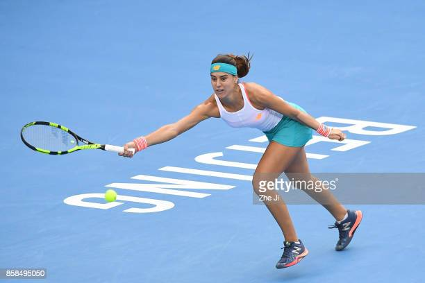 Sorana Cirstea of Romania returns a shot against Jelena Ostapenko of Latvia during the Women's Quarter finals match on day seven of the 2017 China...