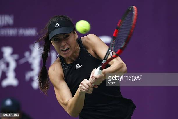 Sorana Cirstea of Romania returns a shot in the quarterfinal match against Zheng Saisai of China during day five of Tianjin Open at Tianjin Tuanbo...