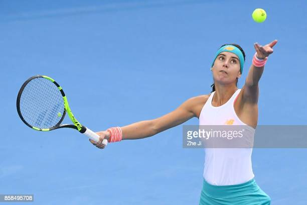 Sorana Cirstea of Romania serves against during the Women's Quarter finals match against Jelena Ostapenko of Latvia on day seven of the 2017 China...