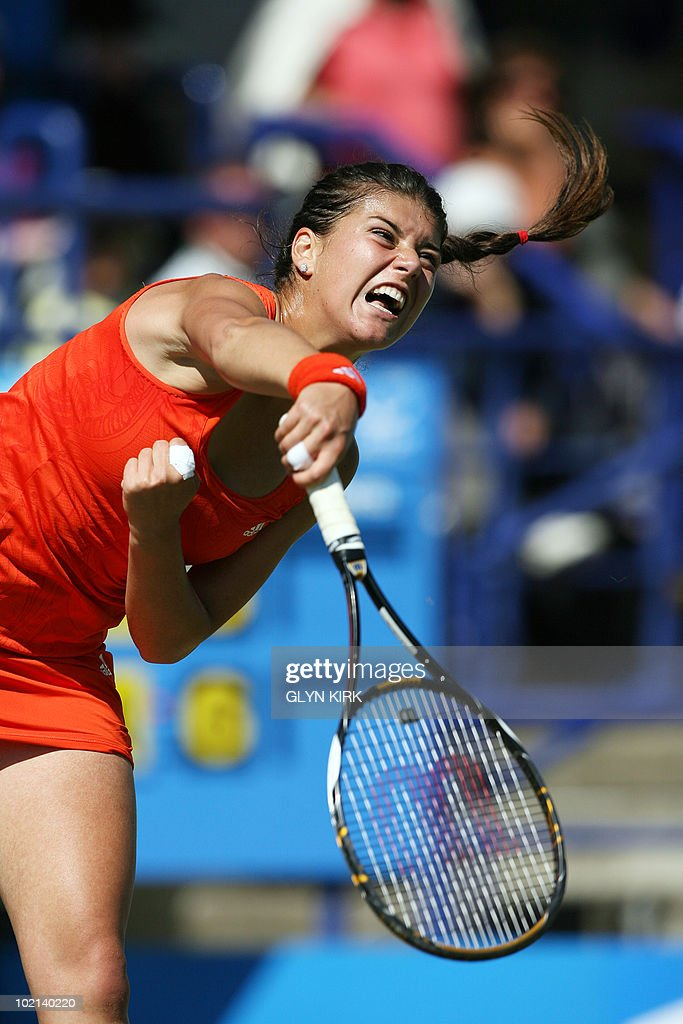 Sorana Cirstea of Romania serves during her second round singles match against Svetlana Kuznetsova of Russia on the third day of the AEGON International tennis tournament in Eastbourne, southern England, on June 16, 2010.