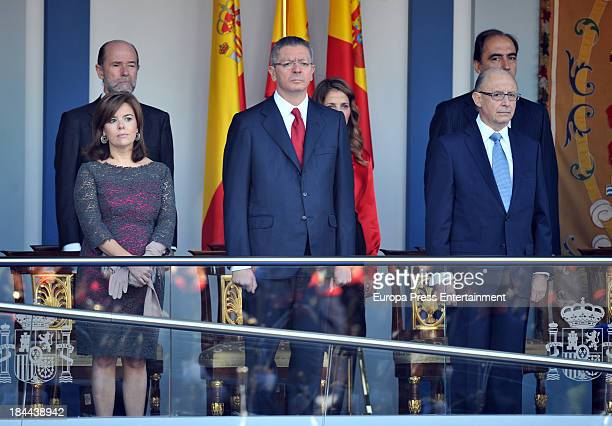 Soraya Saenz de Santamaria Alberto Ruiz Gallardon and Cristobal Montoro attend the National Day Military Parade on October 12 2013 in Madrid Spain
