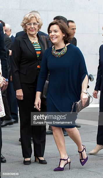 Soraya Saenz de Santamaria and Manuela Carmena attend the opening of the painting exhibition 'The Bosch' at El Prado Museum on May 30 2016 in Madrid...