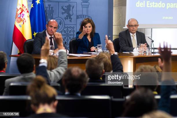Soraya Saenz de Santamaria Spain's deputy prime minister center invites a question from the audience while Luis de Guindos Spain's economy minister...