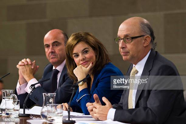 Soraya Saenz de Santamaria Spain's deputy prime minister center and Luis de Guindos Spain's economy minister left listen while Cristobal Montoro...