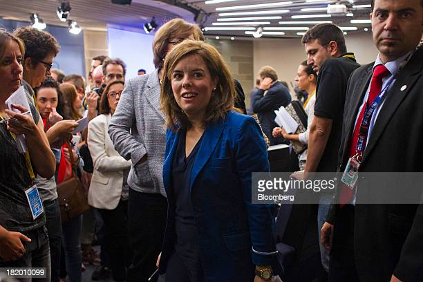 Soraya Saenz de Santamaria Spain's deputy prime minister center leaves after a news conference to discuss the 2014 budget at the Moncloa Palace in...