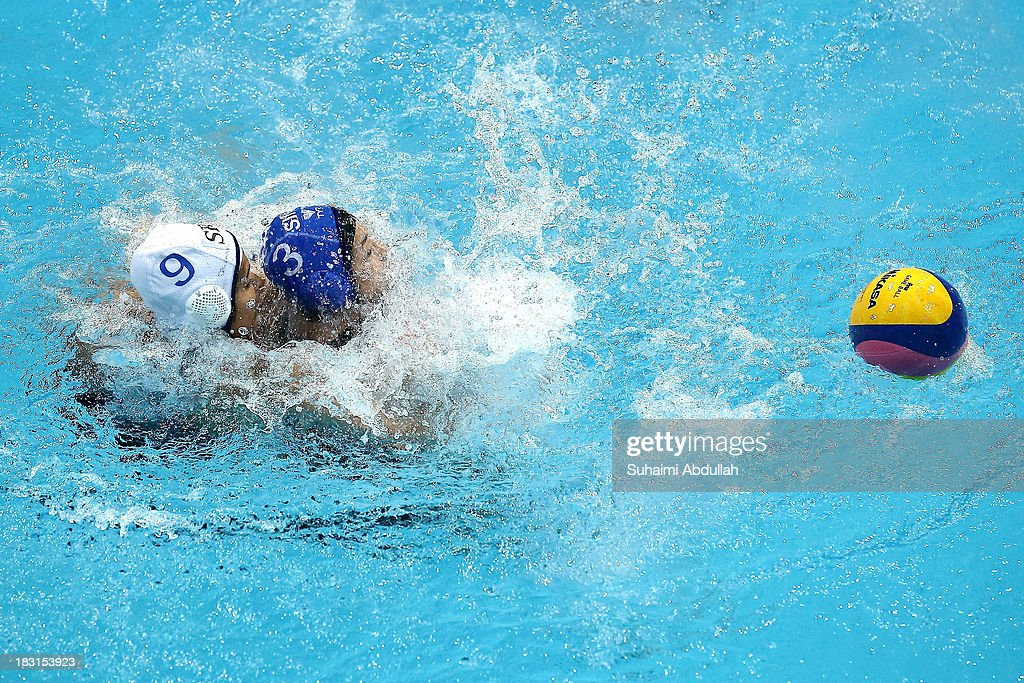 Soraya Wickramasekera of Sri Lanka and Tan Su-Lynn of Singapore challenge for the ball during the women Asian Water Polo Cup between Singapore and Sri Lanka at Toa Payoh Swimming Complex on October 5, 2013 in Singapore.