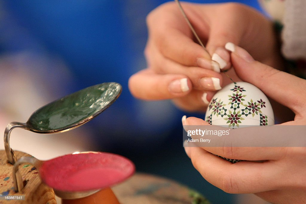 A Sorb egg painter decorates an Easter egg at the annual Easter egg market on March 16, 2013 in Schleife, Germany. Easter is a particularly important time of year for Sorbs, a Slavic minority in eastern Germany, and the period includes the tradition of painting Easter eggs that include visual elements intended to ward off evil. Many Sorbs still speak Sorbian, a language closely related to Polish and Czech.