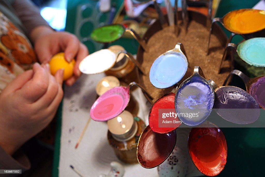 A Sorb egg painter decorates an Easter egg while using bent spoons full of melted wax as coloring at the annual Easter egg market on March 16, 2013 in Schleife, Germany. Easter is a particularly important time of year for Sorbs, a Slavic minority in eastern Germany, and the period includes the tradition of painting Easter eggs that include visual elements intended to ward off evil. Many Sorbs still speak Sorbian, a language closely related to Polish and Czech.
