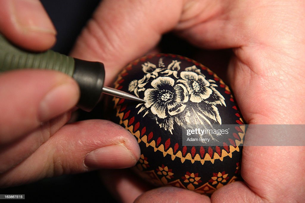 A Sorb egg painter engraves an Easter egg at the annual Easter egg market on March 16, 2013 in Schleife, Germany. Easter is a particularly important time of year for Sorbs, a Slavic minority in eastern Germany, and the period includes the tradition of painting Easter eggs that include visual elements intended to ward off evil. Many Sorbs still speak Sorbian, a language closely related to Polish and Czech.