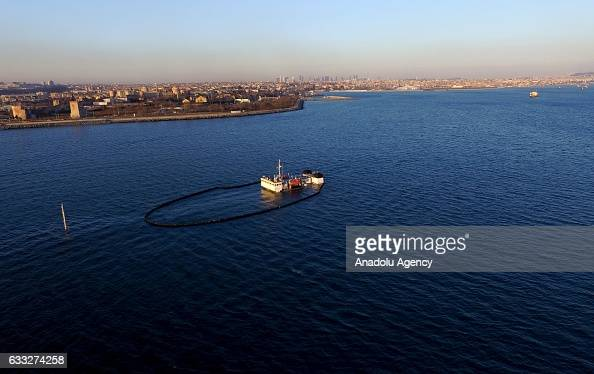 Sorbent boom circle to control spreading the pollution after a Tanzanian dry cargo vessel sank in the Sea of Marmara on the shore of Zeytinburnu...