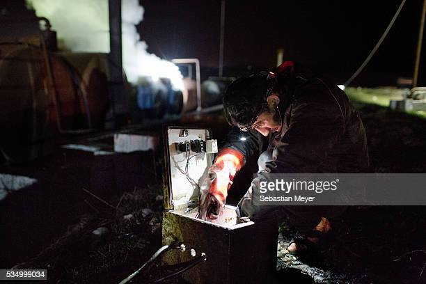 Sorbets adjusts the electric fuel pump at night The family of Yezidis displaced from Sinjar live next to an oil refinery in the Kurdish Region of...