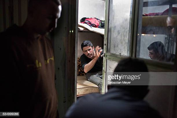 Sorbets talks to his brothersZaidoon Azdar and Sardeshtinside the PVC cabin where he lives The family of Yezidis displaced from Sinjar live next to...
