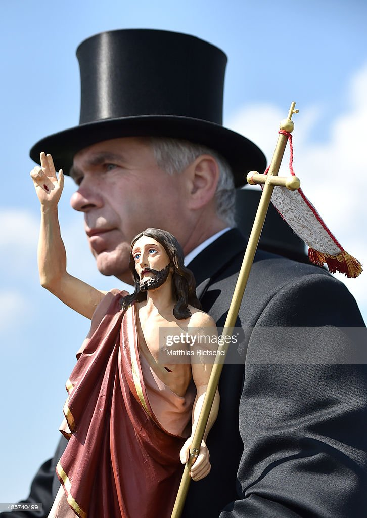 A Sorbian man dressed in traditional costume carries the figur of the ressurected Jesus while a procession to herald the resurrection of Jesus Christ during the annual Sorbian Easter Ride on April 20, 2014 near Crostwitz, Germany. Hundreds of riders in different groups ride between villages in the region and are received by Sorbian women with food and hospitality. Sorbians are a western Slavic minority in eastern Germany who speak a language closely related to Czech and Polish.