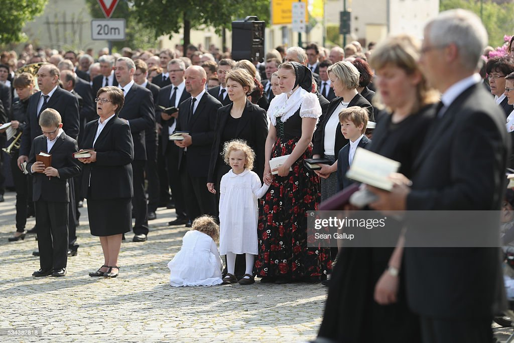 Sorbian men, women and children stop to sing hymns during the annual Sorbian Corpus Christi procession through the village center on May 26, 2016 in Crostwitz, Germany. Sorbians are a Slavic minority in southeastern Germany who speak a language similar to Czech and Polish. Sorbian is still taughet in some schools in the region and a lively tradition of Sorbian literature, theater and folk culture has survived.