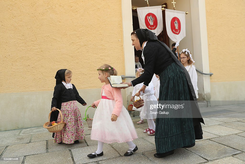 Sorbian women and girls wearing traditional Sorbian festive dress prepare to participate in the annual Sorbian Corpus Christi procession as they emerge from mass in the village church on May 26, 2016 in Crostwitz, Germany. Sorbians are a Slavic minority in southeastern Germany who speak a language similar to Czech and Polish. Sorbian is still taughet in some schools in the region and a lively tradition of Sorbian literature, theater and folk culture has survived.