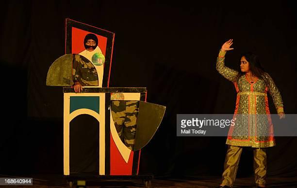 Sorcar Jr performs a magic trick at FICCI auditorium in New Delhi on Saturday