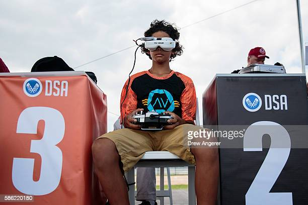 Sorell Miller uses a remote control and cockpit view goggles as he flies his drone during practice day at the National Drone Racing Championships on...