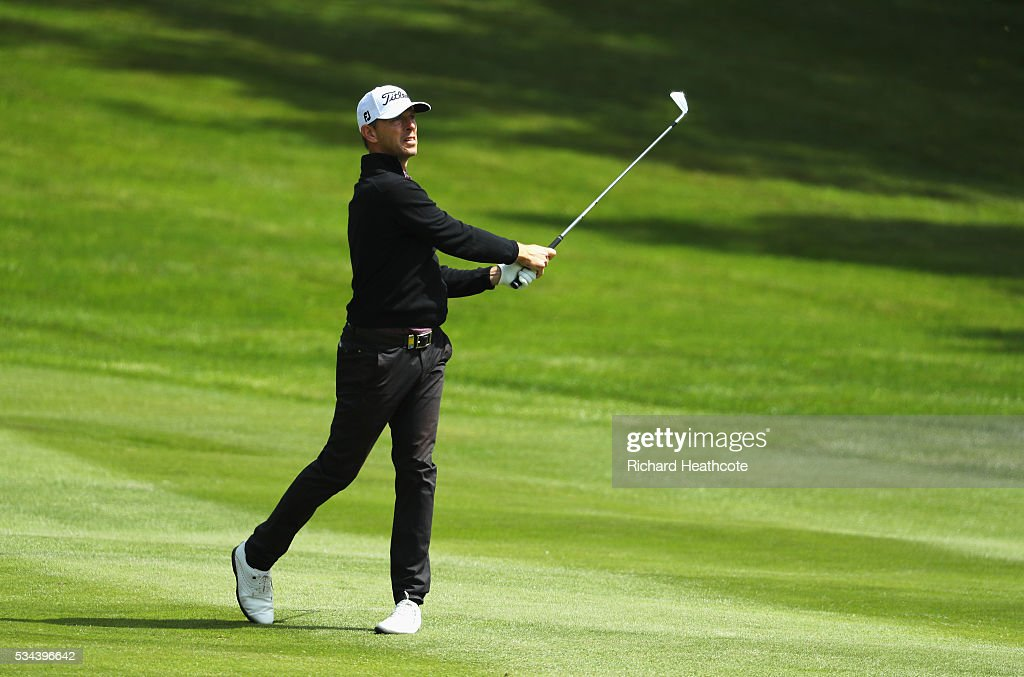 <a gi-track='captionPersonalityLinkClicked' href=/galleries/search?phrase=Soren+Hansen+-+Golfer&family=editorial&specificpeople=15283013 ng-click='$event.stopPropagation()'>Soren Hansen</a> of Denmark hits his 2nd shot on the 4th hole during day one of the BMW PGA Championship at Wentworth on May 26, 2016 in Virginia Water, England.