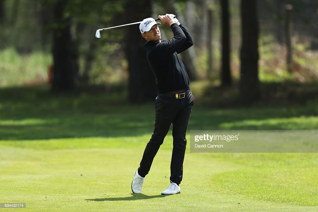Soren Hansen of Denmark hits his 2nd shot on the 9th hole during day one of the BMW PGA Championship at Wentworth on May 26, 2016 in Virginia Water, England.