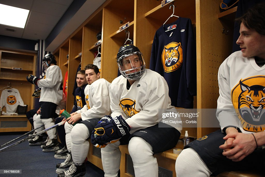 Soren Jonzzon with team mates in the dressing room as players prepare for training during the Quinnipiac University Men's College Ice Hockey team...