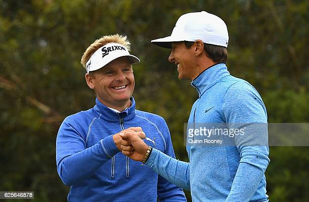 Soren Kjeldsen and Thorbjorn Olesen of Denmark celebrate a birdie during day two of the World Cup of Golf at Kingston Heath Golf Club on November 25...