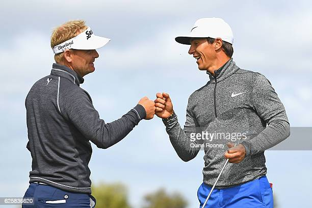 Soren Kjeldsen and Thorbjorn Olesen of Denmark celebrate a birdie during day three of the World Cup of Golf at Kingston Heath Golf Club on November...