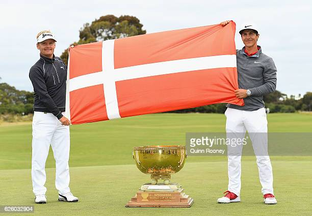 Soren Kjeldsen and Thorbjorn Olesen of Denmark pose with the trophy after winning the tournament during day four of the World Cup of Golf at Kingston...
