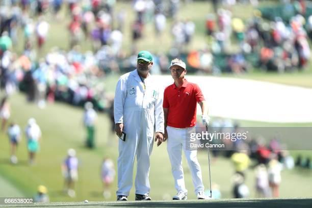 Soren Kjeldsen of Denmark and caddie Alistair Matheson talk on the first fairway during the final round of the 2017 Masters Tournament at Augusta...