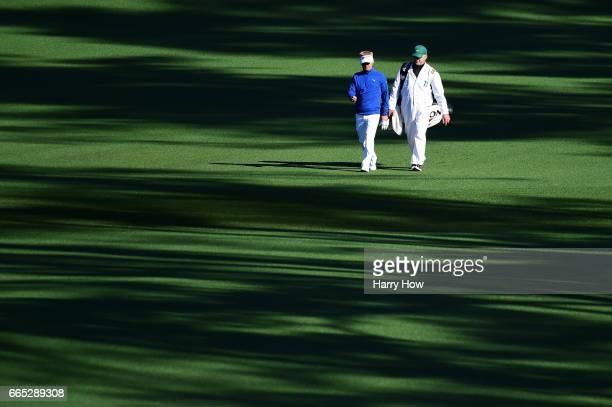 Soren Kjeldsen of Denmark and caddie Alistair Matheson walk the second fairway during the first round of the 2017 Masters Tournament at Augusta...