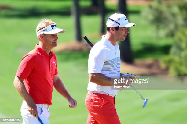 Soren Kjeldsen of Denmark and Paul Casey of England walk off the seventh hole during the final round of the 2017 Masters Tournament at Augusta...