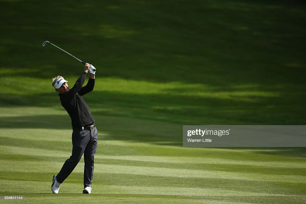 <a gi-track='captionPersonalityLinkClicked' href=/galleries/search?phrase=Soren+Kjeldsen&family=editorial&specificpeople=242923 ng-click='$event.stopPropagation()'>Soren Kjeldsen</a> of Denmark hits his 2nd shot on the 4th hole during day two of the BMW PGA Championship at Wentworth on May 27, 2016 in Virginia Water, England.