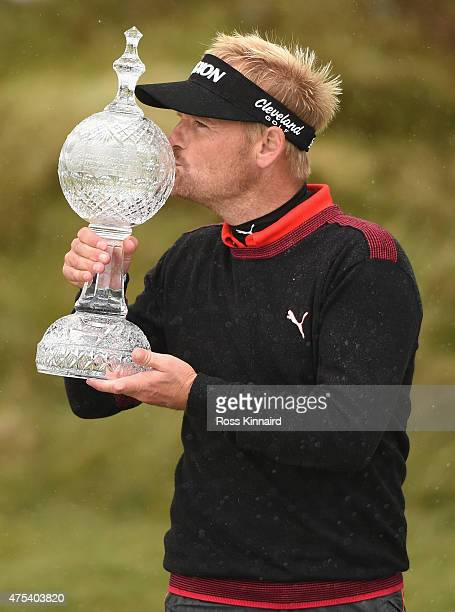 Soren Kjeldsen of Denmark kisses the trophy after his victory in a playoff during the Final Round of the Dubai Duty Free Irish Open Hosted by the...