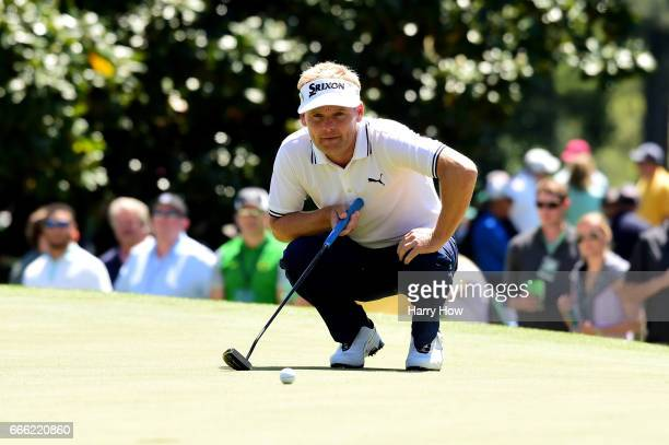 Soren Kjeldsen of Denmark lines up a putt on the first hole during the third round of the 2017 Masters Tournament at Augusta National Golf Club on...