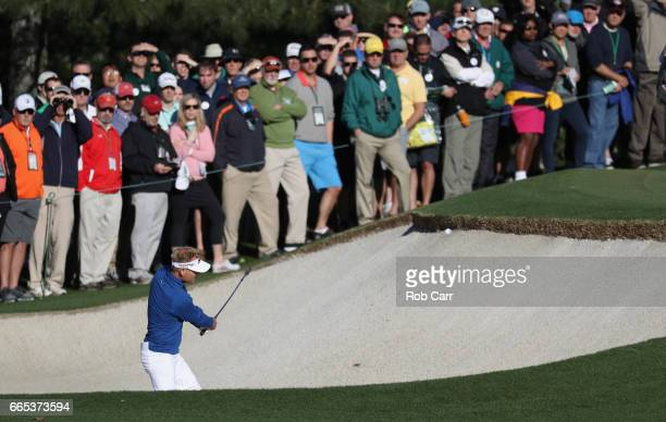 Soren Kjeldsen of Denmark plays a shot from a bunker on the first hole during the first round of the 2017 Masters Tournament at Augusta National Golf...