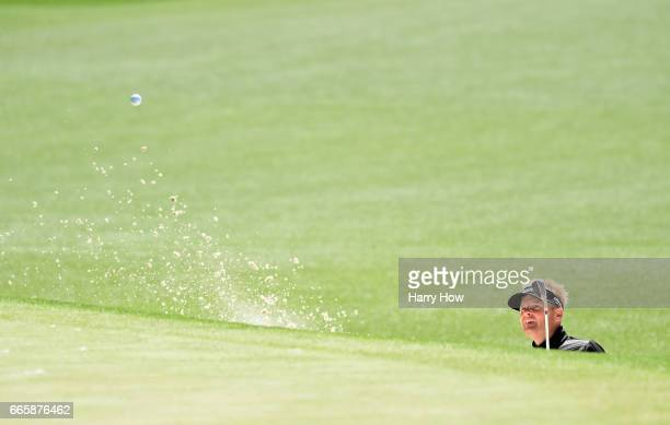 Soren Kjeldsen of Denmark plays a shot from a bunker on the first hole during the second round of the 2017 Masters Tournament at Augusta National...