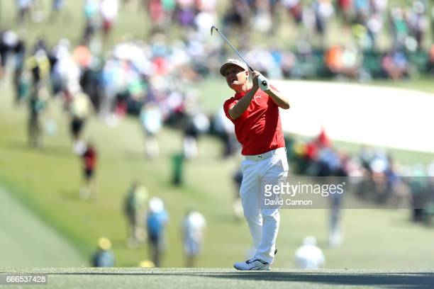 Soren Kjeldsen of Denmark plays his second shot on the first hole during the final round of the 2017 Masters Tournament at Augusta National Golf Club...