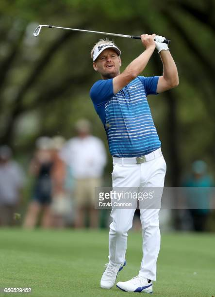 Soren Kjeldsen of Denmark plays his second shot on the par 4 first hole in his match against Rory McIlroy of Northern Ireland during the first round...