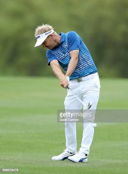Soren Kjeldsen of Denmark plays his second shot on the par 4 second hole in his match against Rory McIlroy of Northern Ireland during the first round...